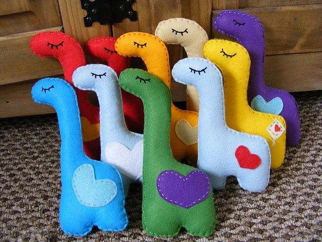 Felt Dinosaurs! Could add numbers or letters or the written colour to incorporate a learning game