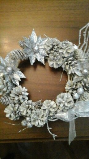 Having fun making wreaths:) I bought rolls of grapevine at Michael's, picked pinecones from my yard....spray painted everything and added embellishments.