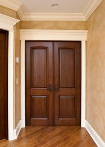 Custom Solid Wood Interior Door in cherry wood with walnut finish for the den for the colour and solidness