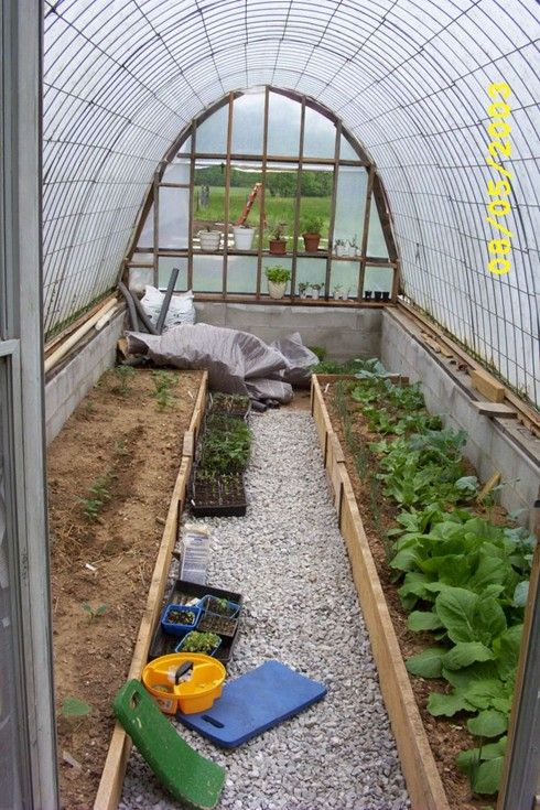 Greenhouse made from cattle panels at http://inmykitchengarden.blogspot.com/2006/03/looking-back-building-greenhouse.html.