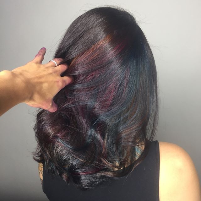 FAN SHARE: PEEK-A-BOO #OILSLICKHAIR  Lindsey Livinston @linzlivingston of Eden Salon and Barbershop had a model who had never done creative color before, but wanted to try the new peek-a-boo oil slick effect that was trending on Instagram earlier this year. She went to work and the result is as fun as it is subtle.