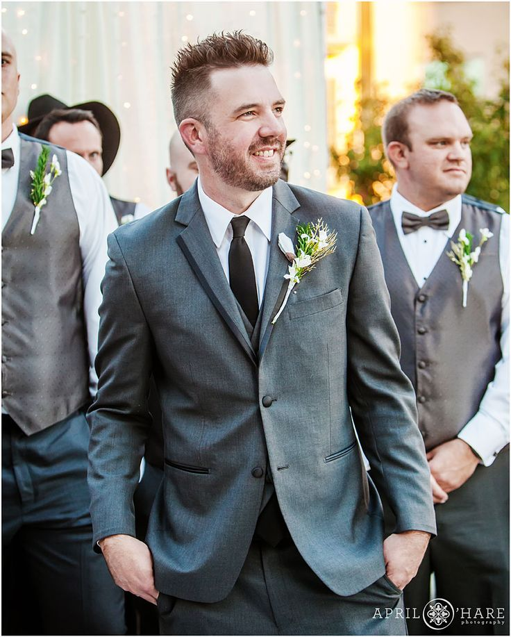 Groom Watches As His Bride Makes Her Way Down The Aisle At Their Modern Rooftop  Patio