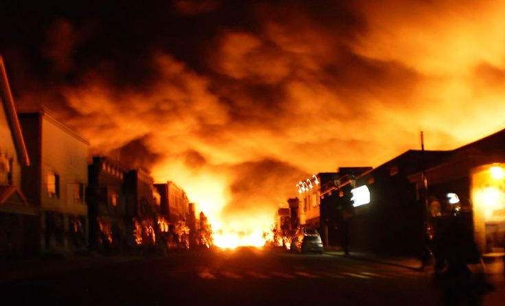 An unbelievable sight of the picturesque town of Lac-Mégantic, Quebec, erupting in a literal ball of fire after 5 unattached oil tankers crashed and exploded in the town center. (REUTERS) July 2013.