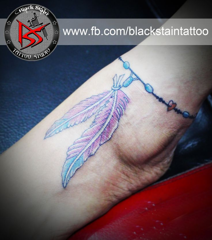 Beautiful feathers of bird tied  up with an anklet                        Done by DHARMESH MAGRA            of BLACK STAIN TATTOO STUDIO