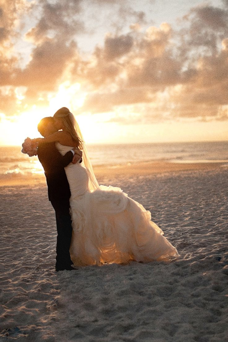 Wedding gown doesn't have to be short or bohemian style, but can be elegant even on the beach.