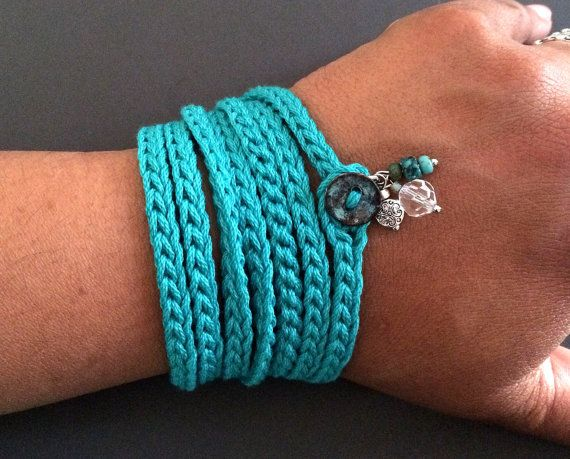 Crochet wrap bracelet or necklace made of cotton yarn in a beautiful rich shade of teal featuring beaded glass and natural stone charms. This fun and versatile accessory is approximately 54 (137.16 cm) long and wraps about 7 times around a 6 - 7 wrist but can be wrapped more or less times to fit any size. This fun wrap also makes a simple, soft necklace that can be worn wrapped, knotted, layered and many other ways around your neck - let your imagination guide you! Closes with a loop and…