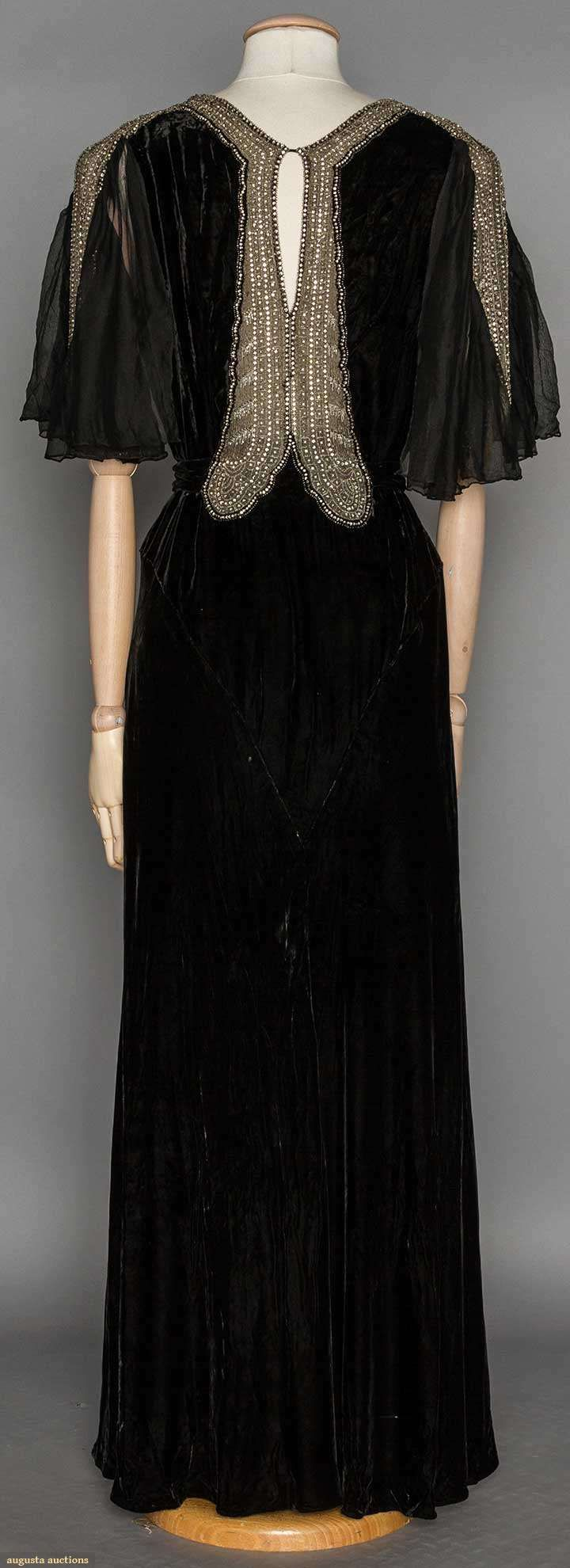 RHINESTONE TRIMMED EVENING GOWN, 1930's | Black silk velvet, chiffon flutter short sleeves, key-hole back, silver metallic w/ rhinestone neck & sleeve trim (back view)