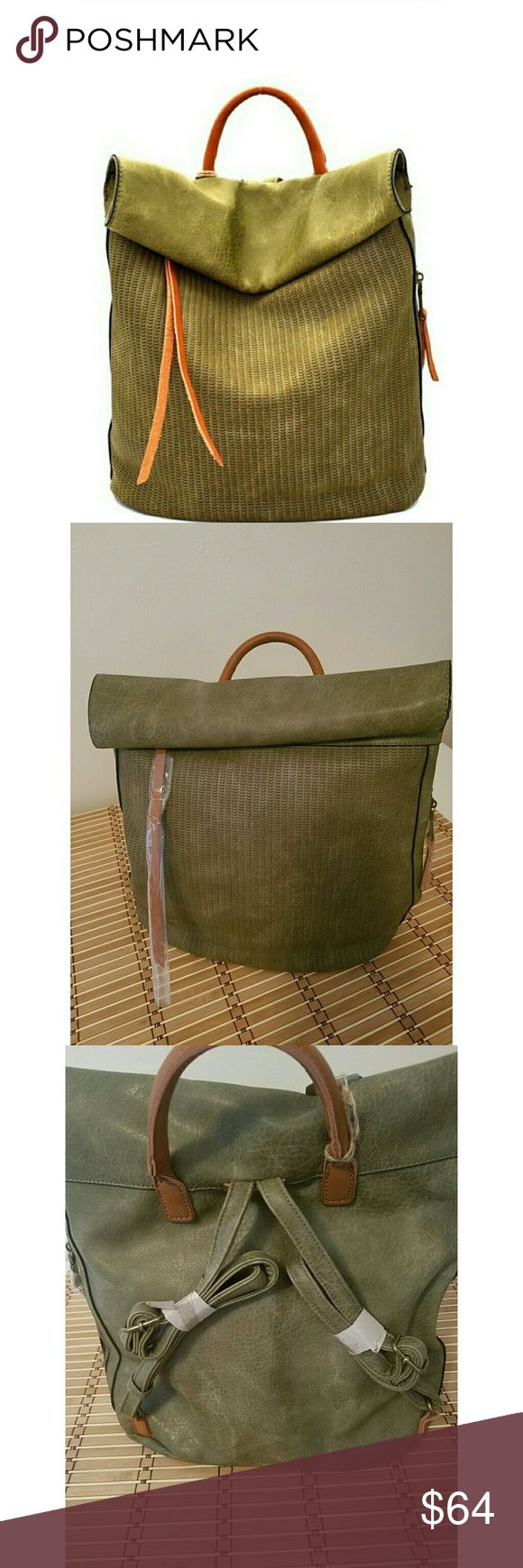 """🚨 It Bag - Vegan Leather Roll Top Backpack Olive New with tags  Vegan leather with coordinating brown top handle and adjustable straps    ❤ Slightly distressed ❤ Laser cut out design ❤ Side zip pocket to keep small essentials close at hand   ❤ Inner zip pocket ❤ Inner dual pouch compartment   ❤ Zip and magnetic closure  ~ 13"""" X  13"""" Bags Backpacks"""