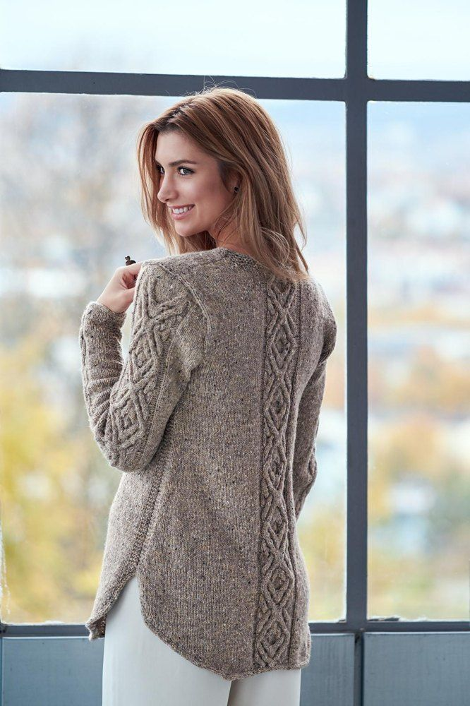 A shadow diamond cable dominates this a-line sweater with a curved flattering…