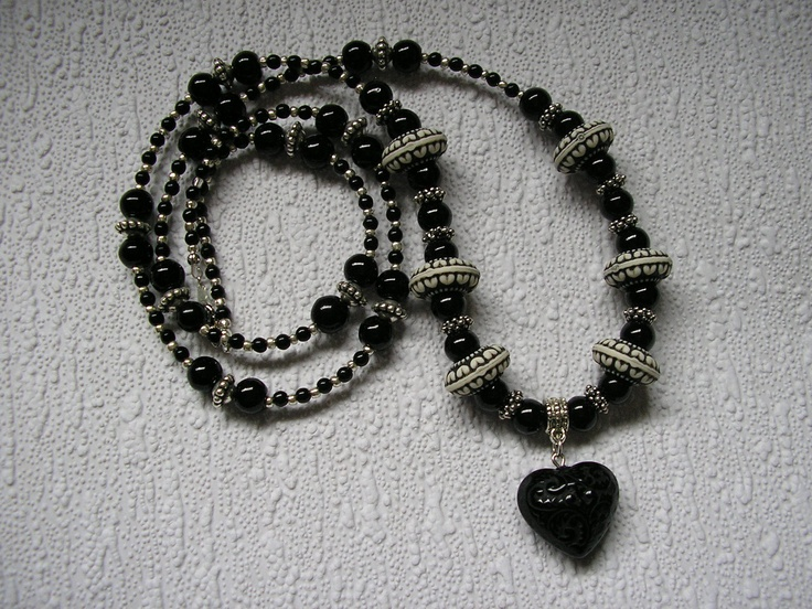 Black and Silver Necklace - Embossed Heart pendant.