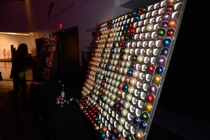 Sponsor Nespresso designed an interactive coffee-pod wall, arranged by color, where guests could pick and choose their caffeinated drink of choice. Guests could then bring the coffee pods over to a Nespresso machine to brew a hot drink.  Photo: Tom Sandler