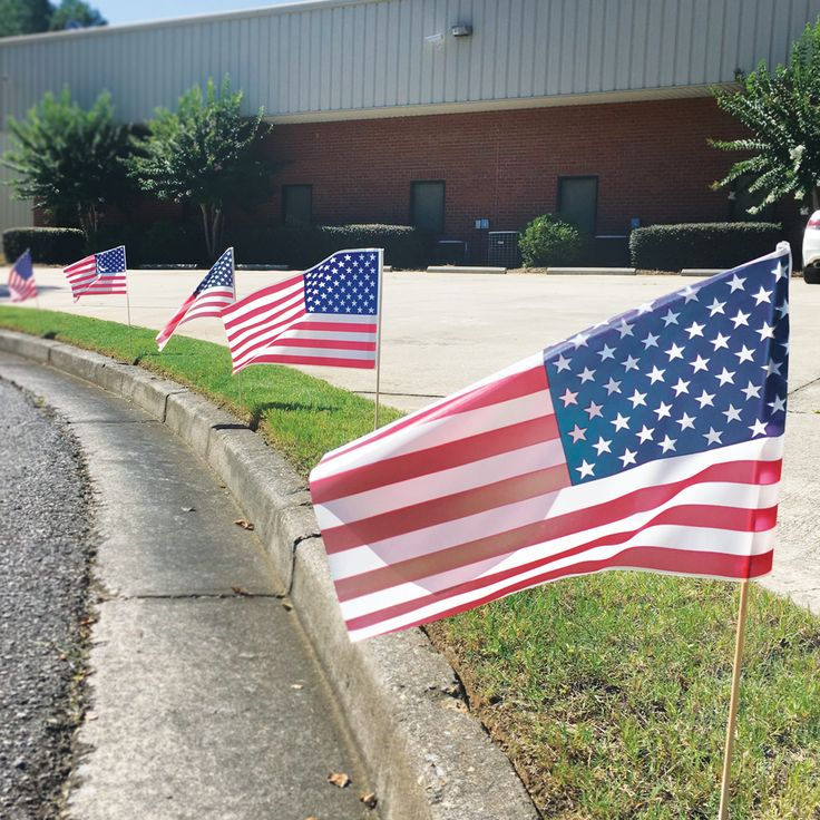 Do you decorate for the 4th of July? We do at The Flag Company! Check out our iconic Farming Flags swaying in the breeze.  #FlagCo #FarmingFlag #July4th #IndependenceDay #Holiday #Celebrate #Patriotic