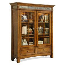 Features: -American style. -Two top doors with glass inserts enclose two accent lights with a touch switch. -Americana oak finish. -Tip restraining hardware. -Two adjustable wood - framed glass s