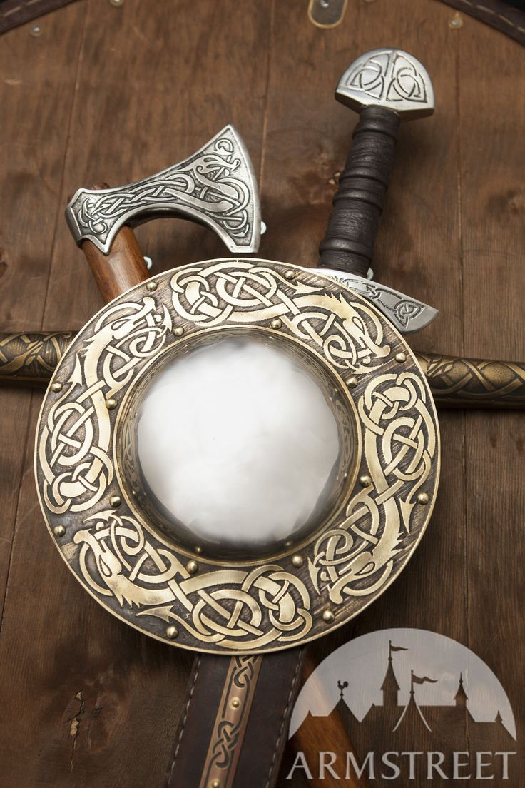 "Traditional Viking brass shield boss with ArmStreet signature etching. This boss is decorated with ""Dragon"" pattern and will look good on your combat viking shield"