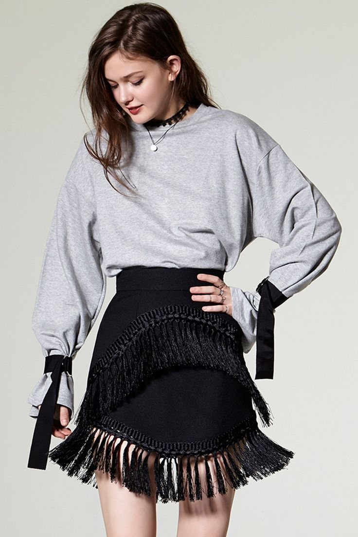 Yena Tassel Skirt Discover the latest fashion trends online at storets.com