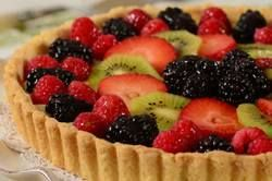 Everyone loves the elegance of a fruit tart with its topping of beautiful fresh fruit. Whether you use a single fruit (like strawberries) or a medley of berries, sliced kiwi, plums, bananas, pineapple, and/or melon no one can resist its beauty. From Joyofbaking.com With Demo Video
