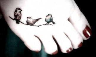 three little birds tattoo... i <3 the sentiment of this is, is it wrong that birds freak me out with their beady eyes and claws.