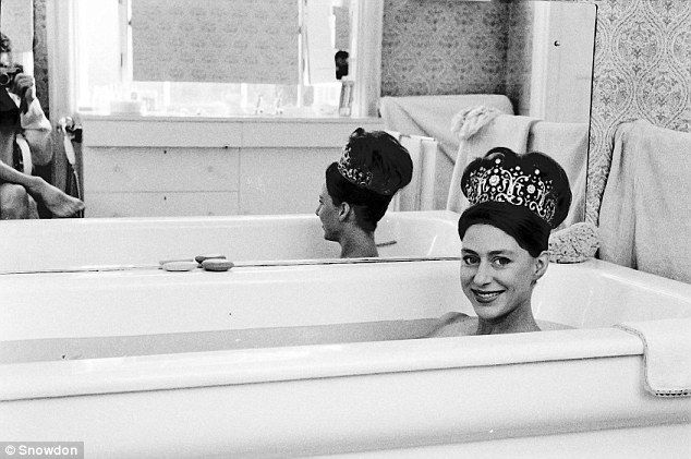 Playful Princess: This picture of Margaret in a bath wearing just a tiara, in 1962, was part of Lord Snowdon's private collection