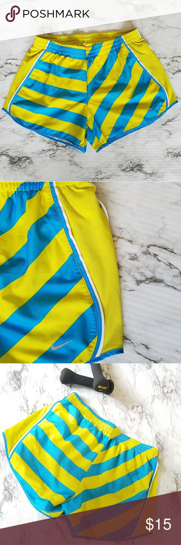 Nike Dri Fit Runing Shorts Striped Blue & Yellow M Nike Dri Fit Runing Active Shorts size M. Vibrant blue and yellow stripes. Blue & white side accent piping.  Interior drawstrings and elastic waist. Inner underwear lining Two internal pockets on the back EUC. Logo shows a small sign of wear, please see pic. Nike Shorts