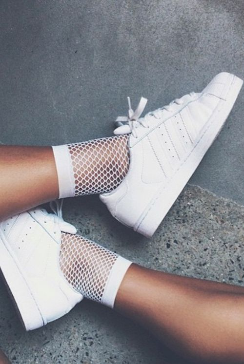 Pair simple white fishnet socks with white sneakers for an edgy twist to a classic. Let Daily Dress Me help you find the perfect outfit for whatever the weather!