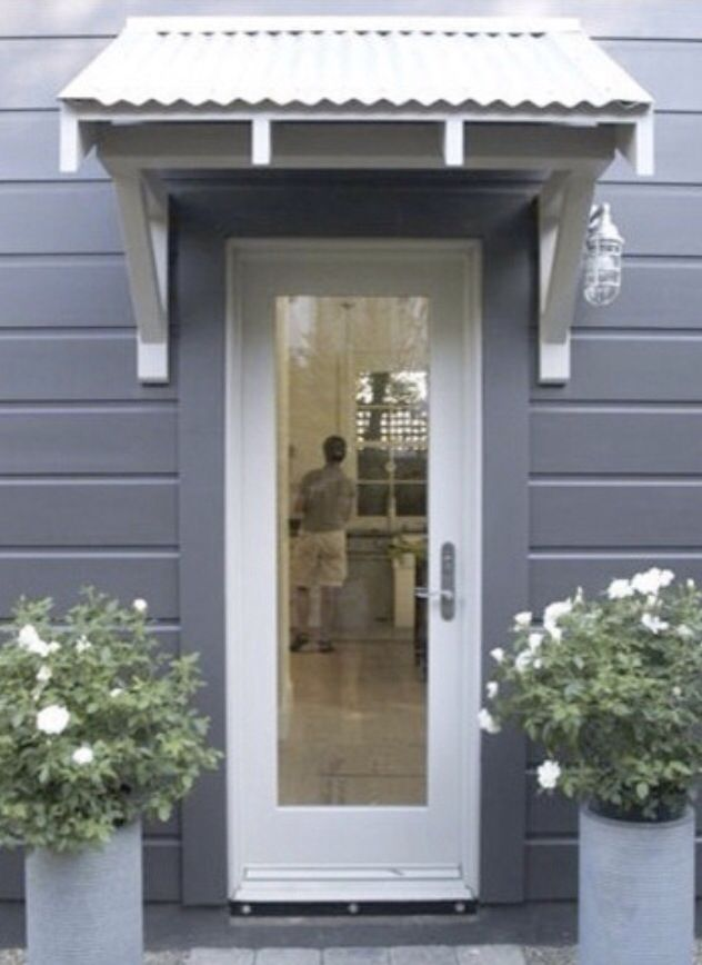 Grey Siding White Trim Overhang Over Door Metal Awning