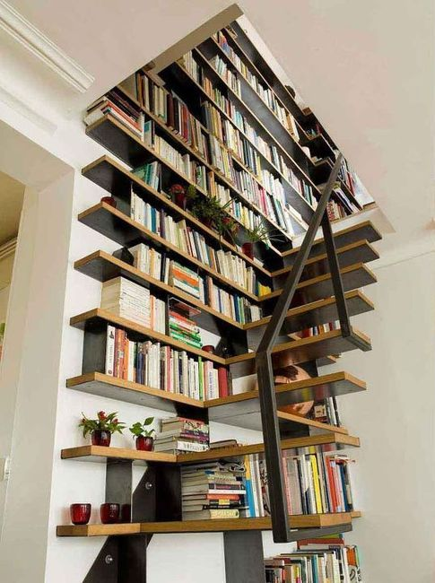 clever use of wasted space - an attic library with a bookshelf staircase leading up to it
