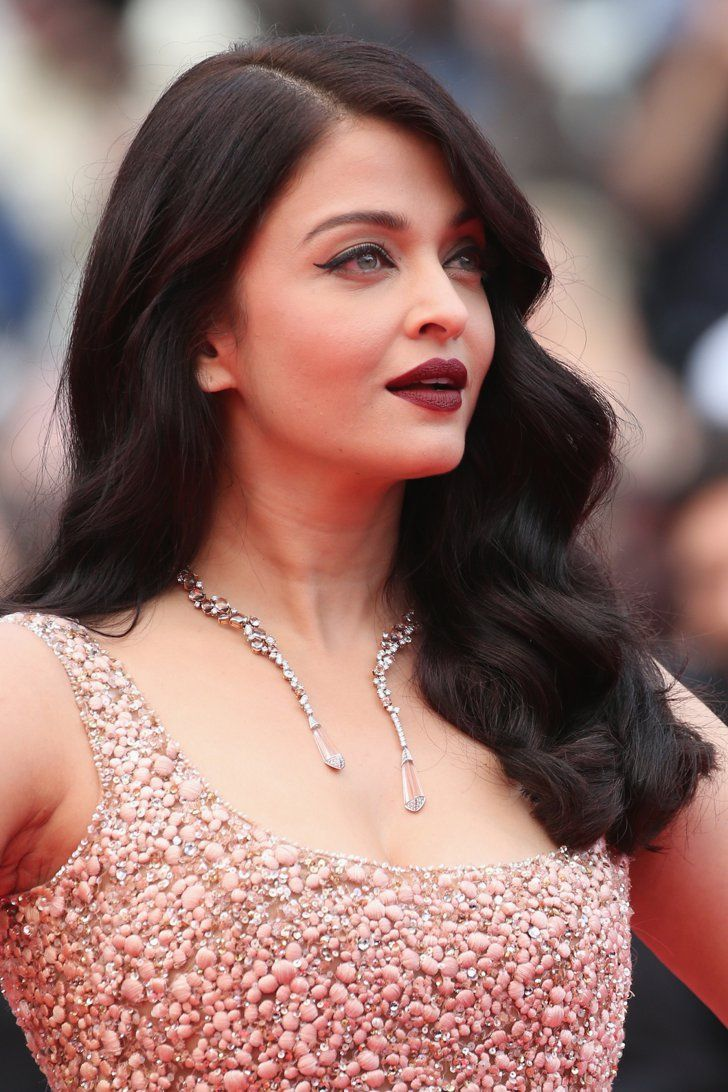 Pin for Later: Every Single Gorgeous Beauty Look From This Year's Cannes Film Festival Day 4 Aishwarya Rai wore a deep oxblood lip that contrasted beautifully with her green eyes at the premiere of The BFG.