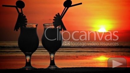 Cocktails at sunset 2 HD Stock Footage Clip. Medium shot. 2012-10-06, INDONESIA.