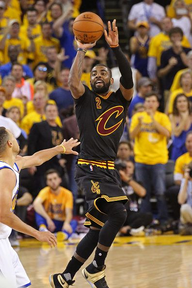 Kyrie Irving of the Cleveland Cavaliers shoots the ball against the Golden State Warriors during the 2016 NBA Finals Game Seven on June 19 2016 at...
