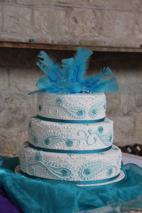Blue/ Teal Paisley wedding cake with feather and crystal topper