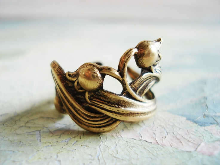 Lily of the valley - Antiqued gold tone brass lily with leaf detailed floral embossed adjustable ring. $8.00, via Etsy.