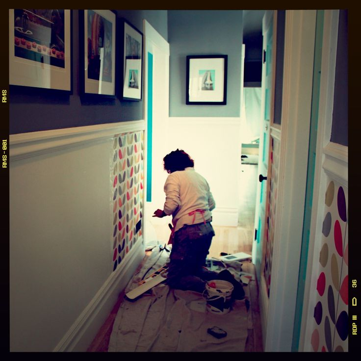 I like the dado rail to divide the hallway walls. paint above and Orla wallpaper below.