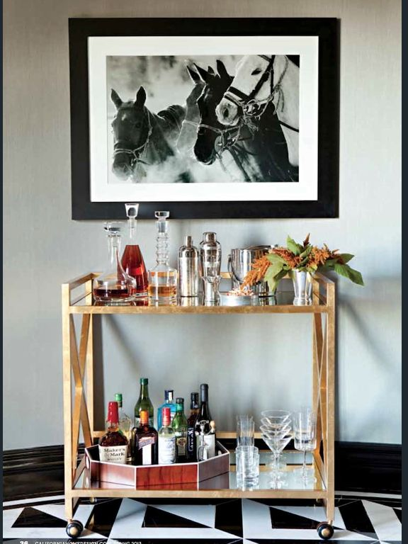 simple bar cart, with all the trimmings, under a large piece of artwork. (this'd go great next to the piano)