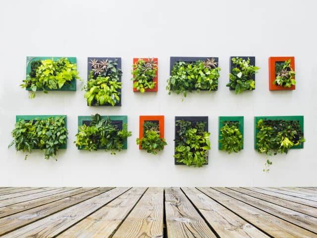What better way to give life to your outdoor space than creating some living art? This interesting wall concept incorporates living plants in place of more traditional décor. This would be a great idea for an outdoor courtyard or even a side garden that has a back wall. The space is so chic that you could host your next party with confidence.
