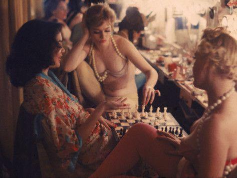Showgirls play chess backstage at the Latin Quarter nightclub, New York, New York, 1958. by Gordon Parks