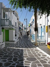 Mykonos, Greece. Amazingly beautiful streets and wind mills and cafes by the sea.