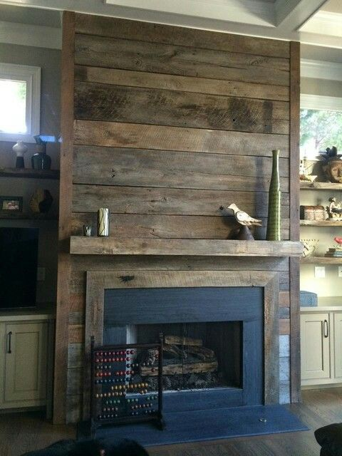 Wood plank fireplace.