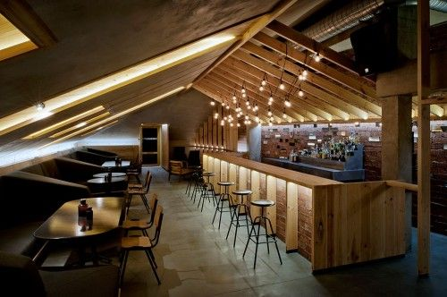 Bar in the Attic is a minimalist interior located in Minsk, Belarus, designed by Inblum. This bar in the attic of a newly rebuilt house in Minsk Old Town stands out as an example of honest use of raw materials. (5)