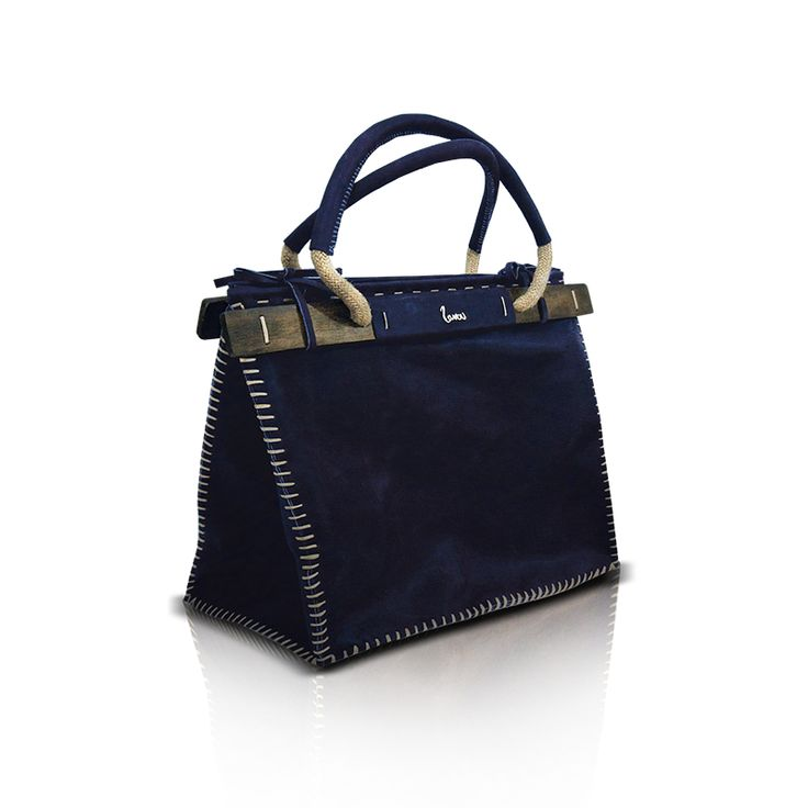 Handmade leather bag with wood and sewing by hand. http://larou.gr/product/zerotwo17/