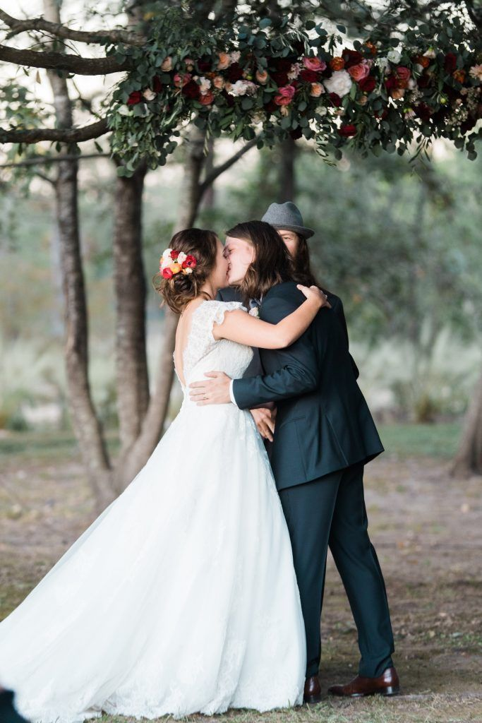 Duck Dynasty's Reed Robertson and Brighton Thompson exchanged vows underneath a massive oak tree located on her parents' property. The couple's florist, Fine Folks, created a gorgeous flower arch to embellish one branch of the mighty tree.