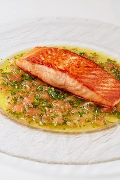 A stalwart of French cuisine, this sauce vierge recipe from chef Steven Doherty includes the core ingredients of fresh tomato, fragrant basil and rich olive oil with a little acidity from freshly squeezed lemon juice. Here the sauce is served with simple pan-fried salmon fillets.