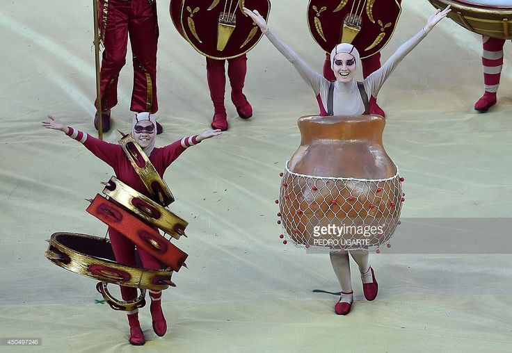 Performers take part in the opening ceremony of the 2014 FIFA World Cup at the Corinthians Arena in Sao Paulo on June 12, 2014, prior to the opening Group A football match between Brazil and Croatia.