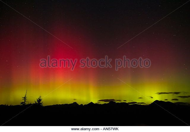 The northern lights (aurora borealis) dance over Three Fingers Mountain in Washington's Central Cascades in October, 2003. - Stock Image