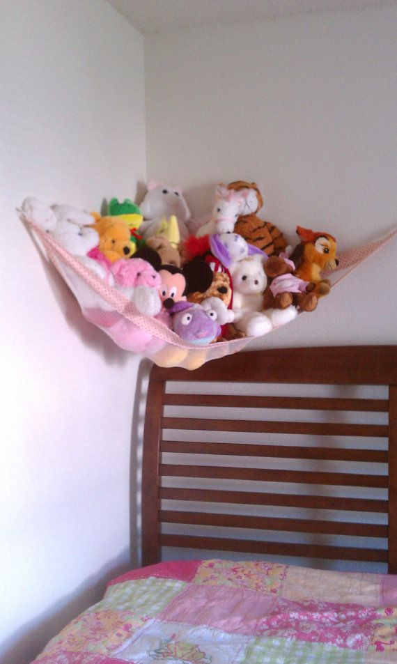 Stuffed Animal Hammock - from dollar store mesh laundry bag. I sewed on pink fleece to cover the raw edges on the sides, then I added grommets to each corner.