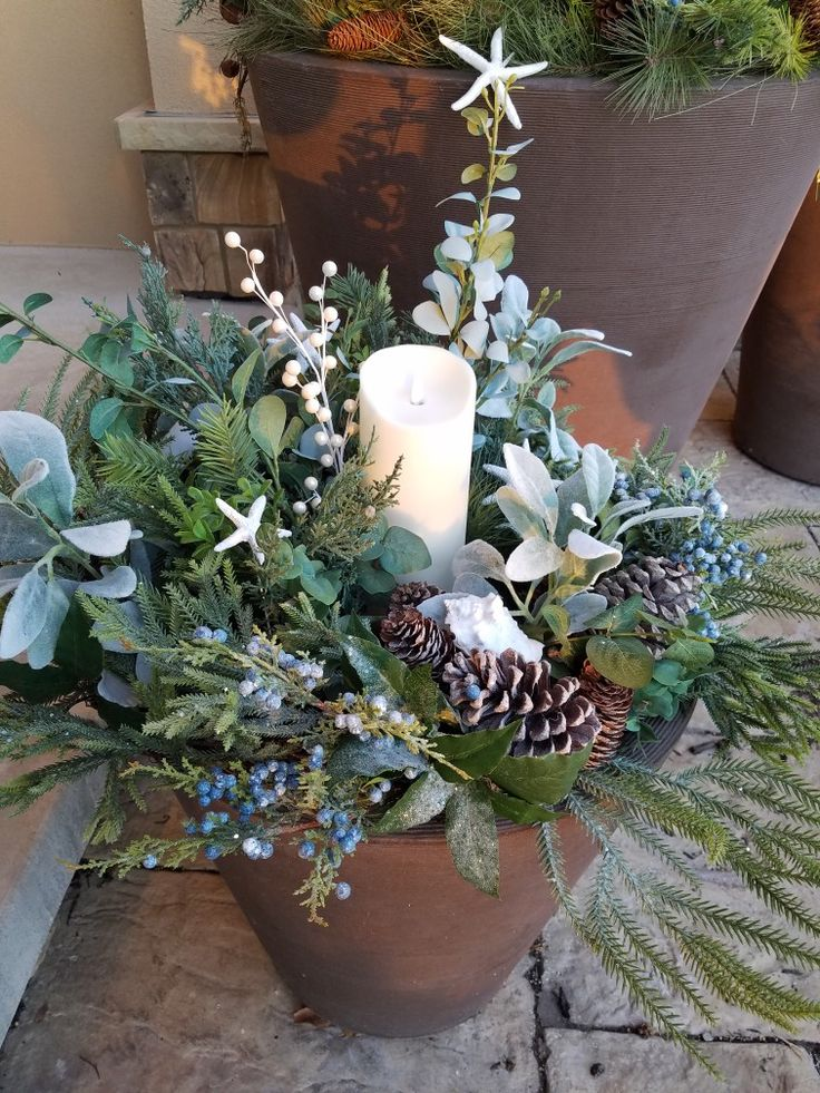 Seaside holiday planter. Eucalyptus, lambs ear, juniper berries and seashells all mixed into winter greenery.