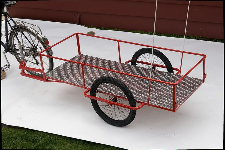 Haulin' Colin Bike Trailers  -  This bike trailer weighs 50 lbs. and will carry 500.  Not everyone could manage that, but, for those that could this will haul a serious load of equipment.  $750
