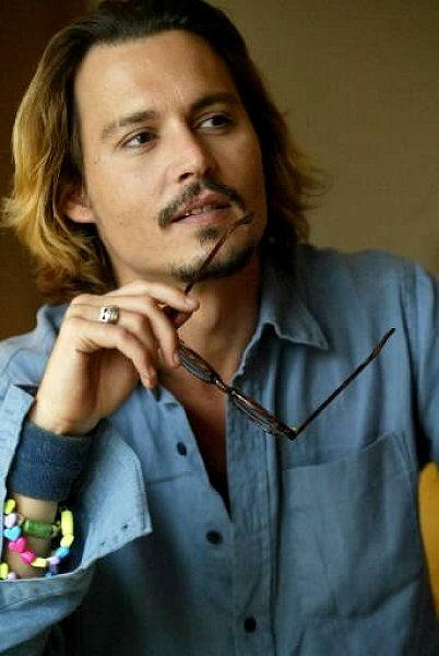 I love this! Tough, cool with his style and skull ring, but look at the plastic heart bracelets that I'm sure his children made him. now look at him again. You can see his heart. Johnny Depp