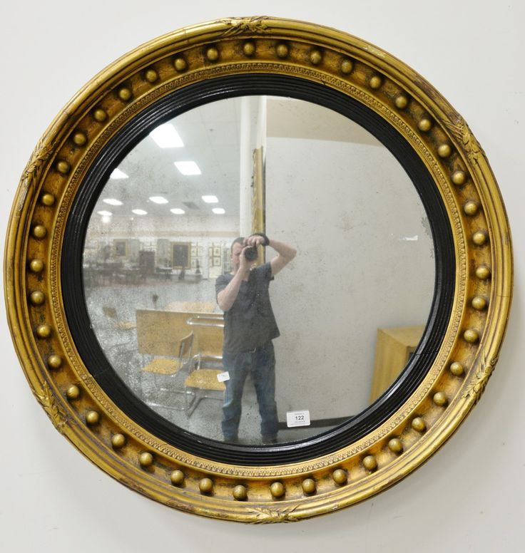 Large Federal convex mirror having parcel ebonized and gold circular form surrounded with spherical decoration.  dia. 32 1/2 in.  Provenance: Property from Credit Suisse's Americana Collection ~Realized Price $2500.00