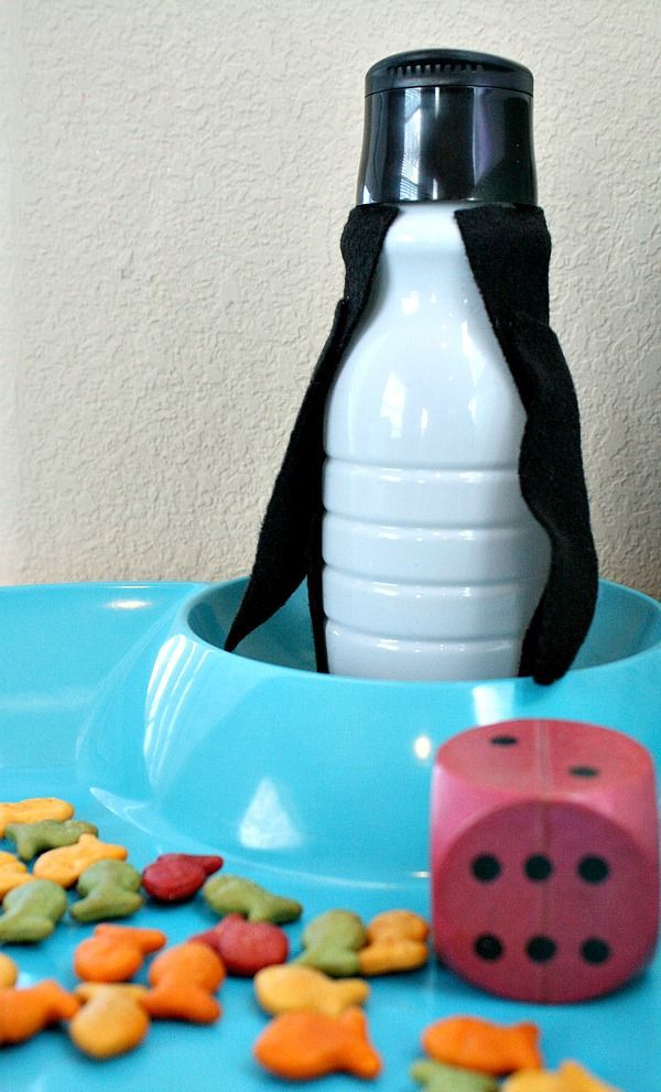 Penguin math game ideas for toddlers and preschoolers. Includes hand-on game for counting and beginning addition.