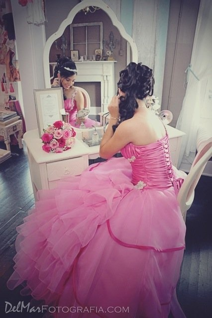 Make sure to get a photo of you getting ready for your Quinceañera